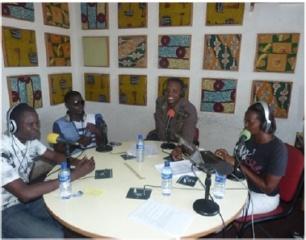 Radio staff members John Habonimana (left), Christian Nsavye (second from right) and Cynthia Ngendakuriyo (far right) host a live talk show.